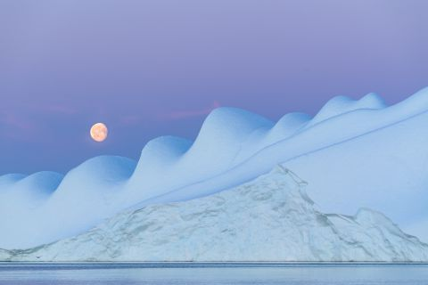 Moonrise above iceberg